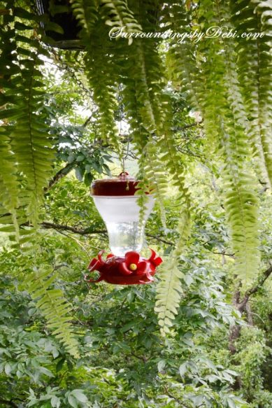 Simple way to add a hummingbird feeder to your outdoor baskets - Surroundings by Debi
