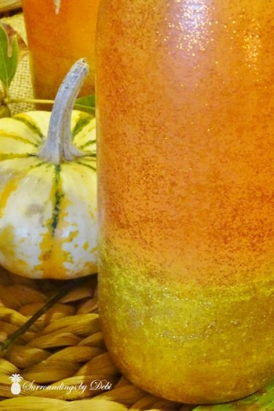 Glittered Candy Corn Wine Bottles with Pumpkin