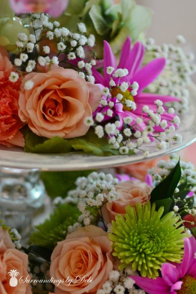 Flowers Added To Tea Pot Centerpiece